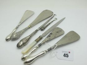 Hallmarked Silver Handled and Other Shoe Horns, a mother of pearl handled letter opener, two