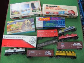 Thirteen Items of 'HO' Gauge U.S.A Outline Rolling Stock, both boxed and unboxed, tank wagons, box
