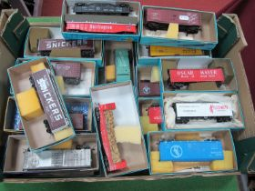 Twenty Four Items of 'HO' Gauge U.S.A Outline Rolling Stock, box vans, ore wagons etc, all contained