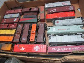 Twenty Four Items of 'HO' Gauge U.S.A Outline Unboxed Rolling Stock, box vans, hoppers, etc, (