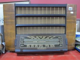 A Regentone Radio, circa mid XX Century in bakelite and walnut effect case 59cm wide.