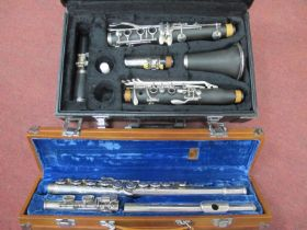 A Clarinet, four sectional, in case, Lark three sectional flute, in case. (2)