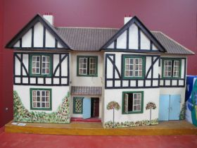 A Vintage Child's Dolls House, with a printed tiled roof, timber fronted painted tree and floral