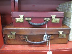 A Small Early XIX Century Leather Suitcase, with brass locks and keys, approximately 45cm wide,