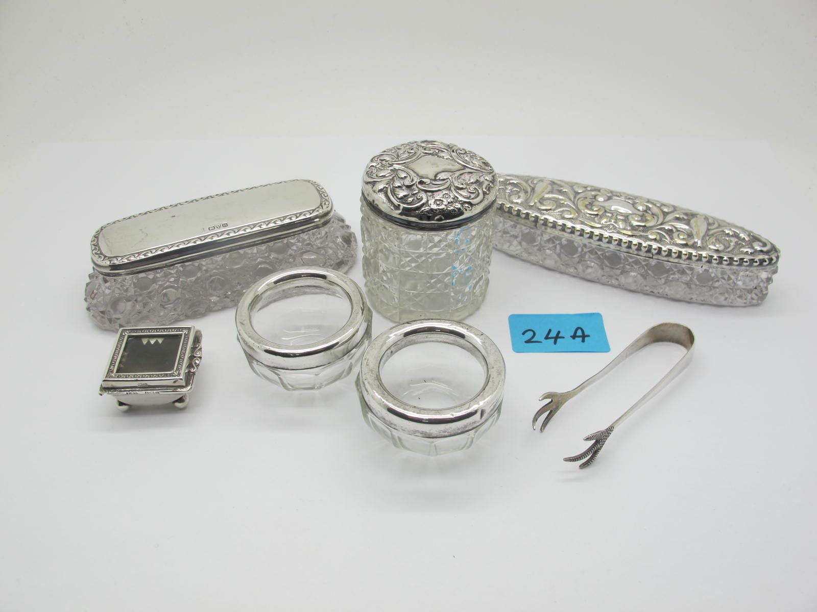 Two Hallmarked Silver Lidded Glass Trinket Boxes, together with a plated example; a pair of