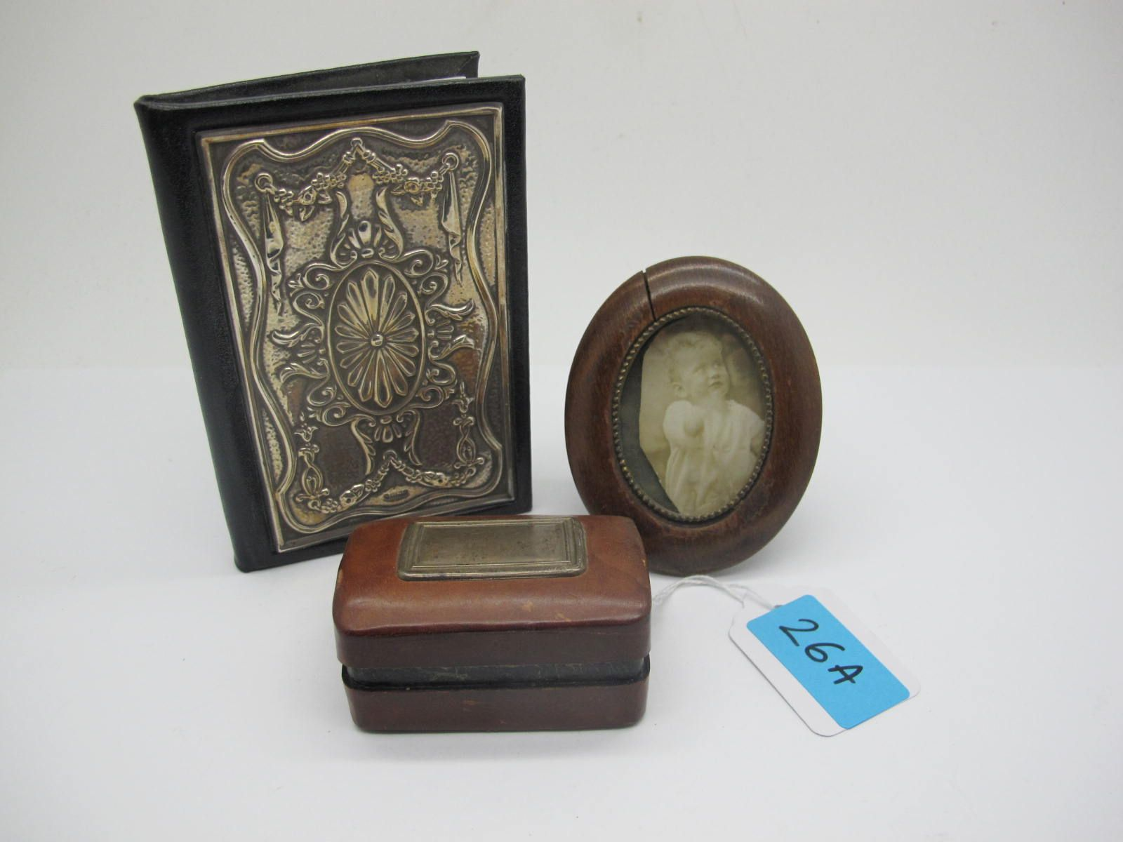 A Hallmarked Silver Mounted Address Book, detailed in relief; together with an Italian leather