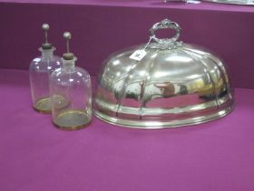 Two c.Early XX Century Leyden Jars, together with an oval plated meat dome. (3)