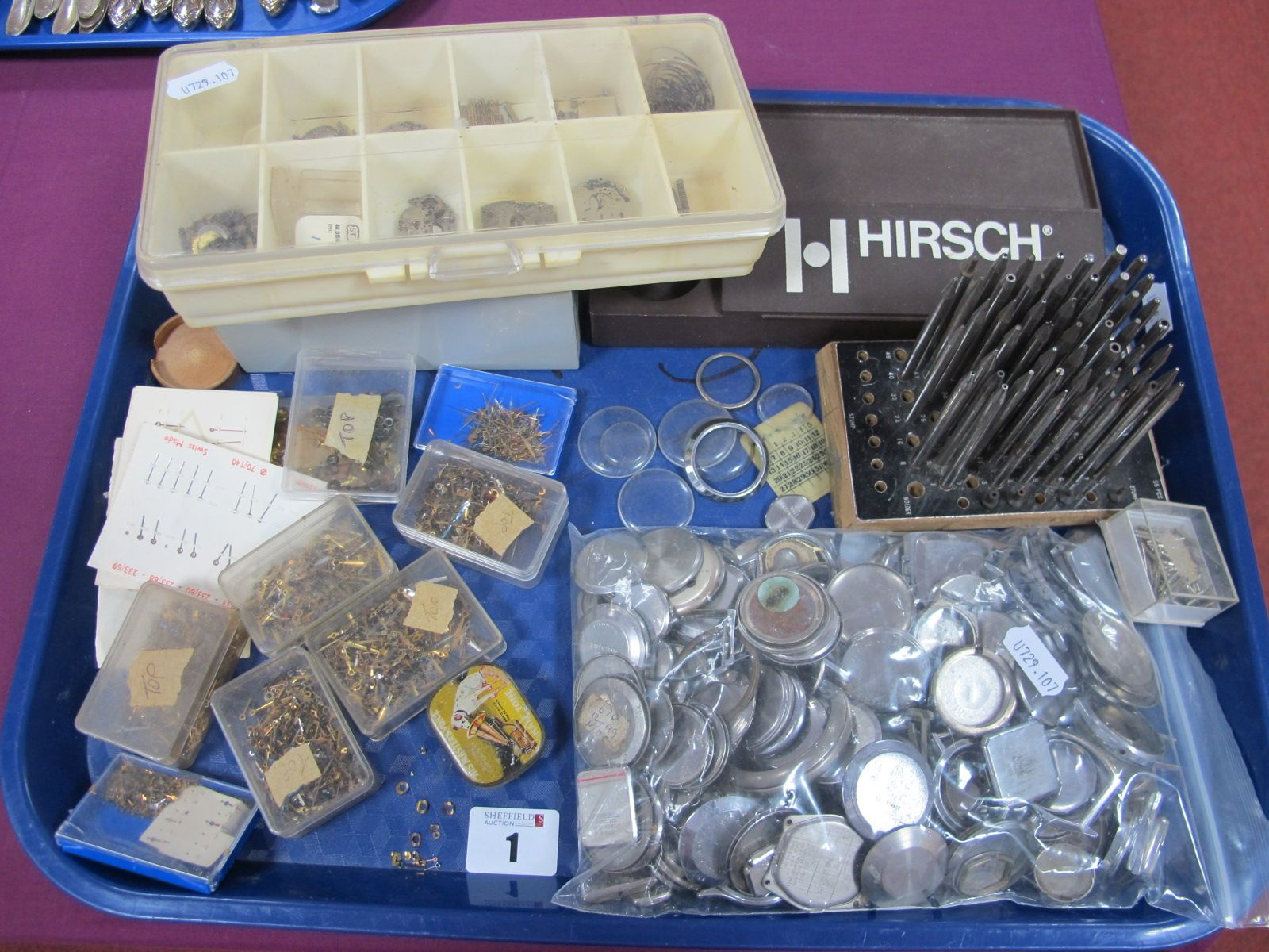 Assorted Watch Components, including wristwatch case backs, assorted hands, staking tool punches,