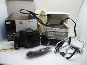 Minolta Dynax 7 Camera, 35mm and instruction manual, boxed, plus Minolta camera guard, boxed. (2)