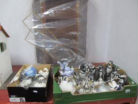 Twelve Franklin Mint Comical Penguin Sculptures, with certificates and six further models similar;