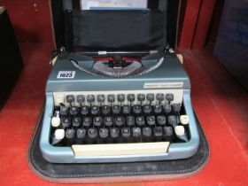 Imperial Good Companion Portable Typewriter, in a brown case.