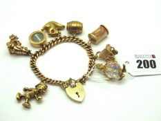 """A Curb Link Charm Bracelet, (links stamped """"9c"""") to a 9ct gold heart shape padlock style clasp,"""