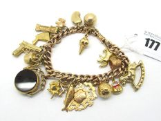 A Curb Link Charm Bracelet, to swivel clasp, suspending numerous assorted novelty charm pendants,