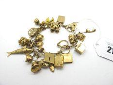 A 9ct Gold Charm Bracelet, to a 9ct gold heart shape padlock style clasp, suspending numerous