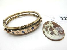 A Victorian Bangle, star set to the front, hinged to snap clasp (lacking safety chain); Together