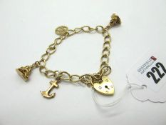 A 9ct Gold Curb Link Charm Bracelet, to 9ct gold heart shape padlock style clasp, suspending two
