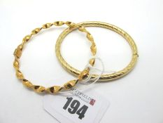 A Modern 9ct Gold Hinged Bangle, of twist design, hinged to snap clasp (internal diameter 6.3cm);