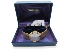 Tissot; A 9ct Gold Cased Gent's Wristwatch, the signed 'Stylist' dial with Roman numerals, the