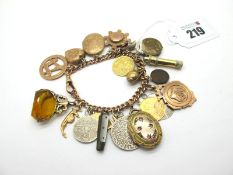A 9ct Rose Gold Curb Link Charm Bracelet, to single swivel style clasp, suspending numerous assorted