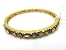 A Decorative Middle Eastern Bangle, with collet set highlights (two missing) and enamel detail,