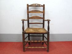 A XIX Century Ash and Elm Ladder Back Armchair, with rushed seat on circular legs united by