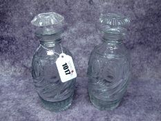 A Pair of Georgian Glass Decanters and Mushroom Stoppers, the ovoid bodies with oval hobnail cut