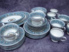 """A Wedgwood Porcelain Dinner and Tea Service, decorated in the """"Florentine"""" pattern, green and"""