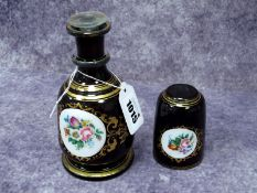 A Bohemian Late XIX Century Decanter and Matching Tumbler, the dark blue grounds each with white