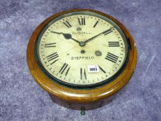 A Burrell Sheffield Oak Cased Wall Clock, the cream enamel dial with Roman numerals, winder present,