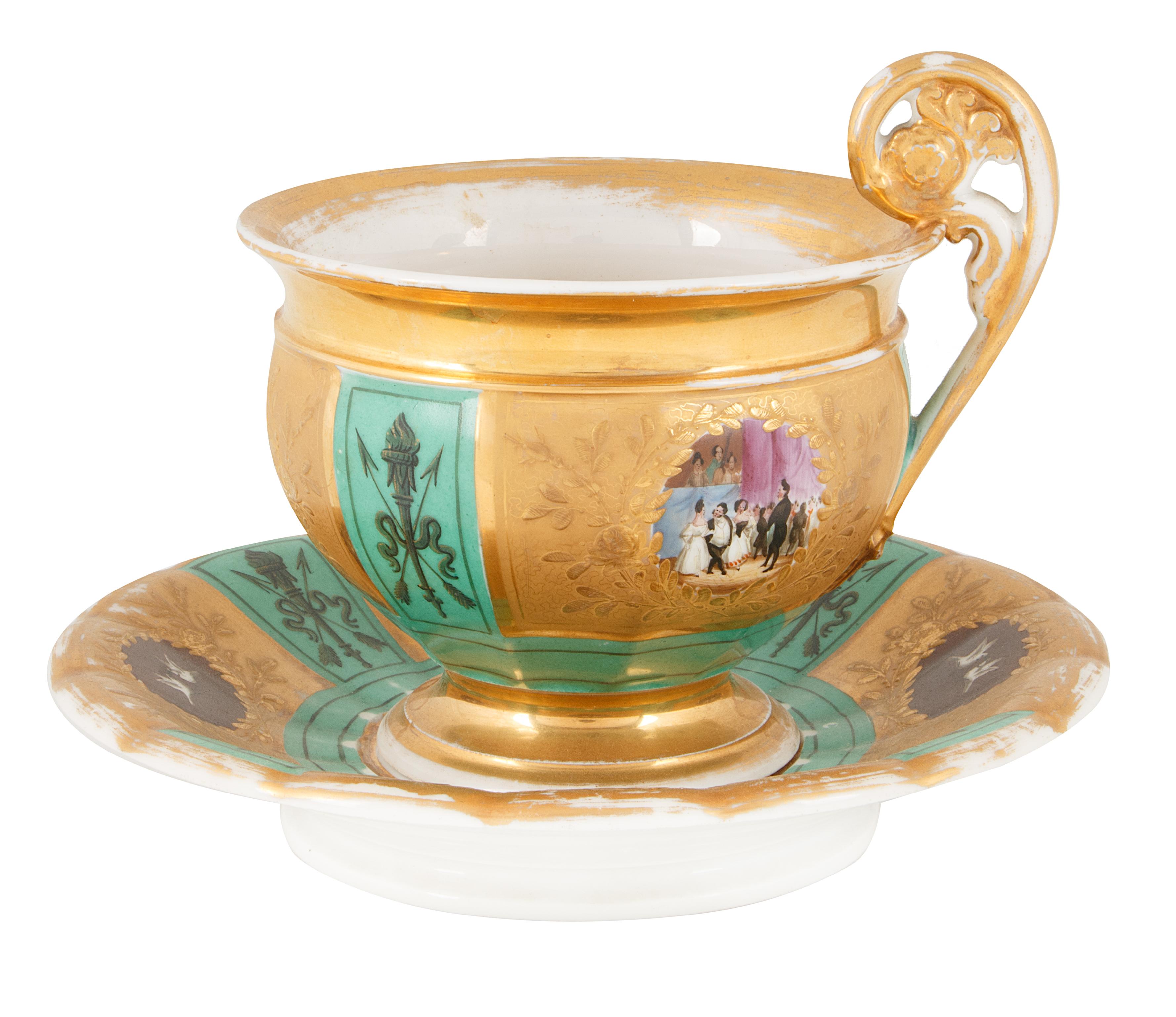 19TH CENTURY GILT PORCELAIN TEA CUP AND SAUCER