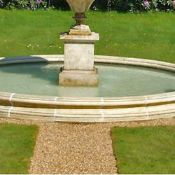 CARVED STONE FOUNTAIN SURROUND