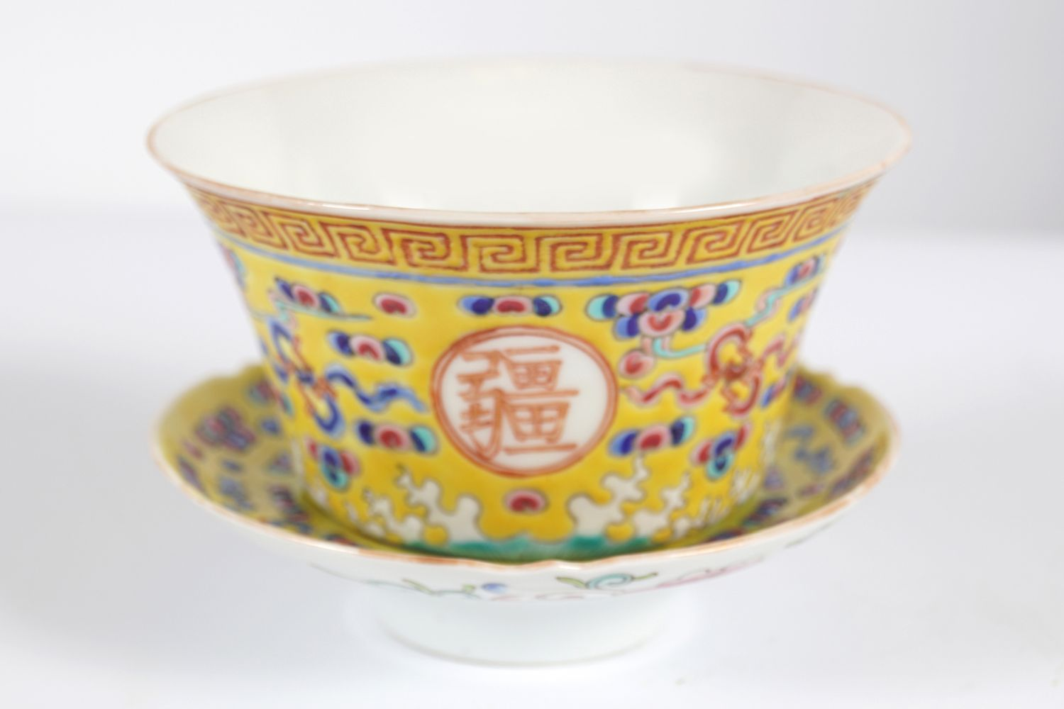 19TH-CENTURY CHINESE FAMILLE ROSE CUP AND SAUCER