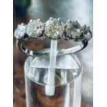 PLATINUM GRADUATED 5 STONE CLAW SET DIAMOND RING