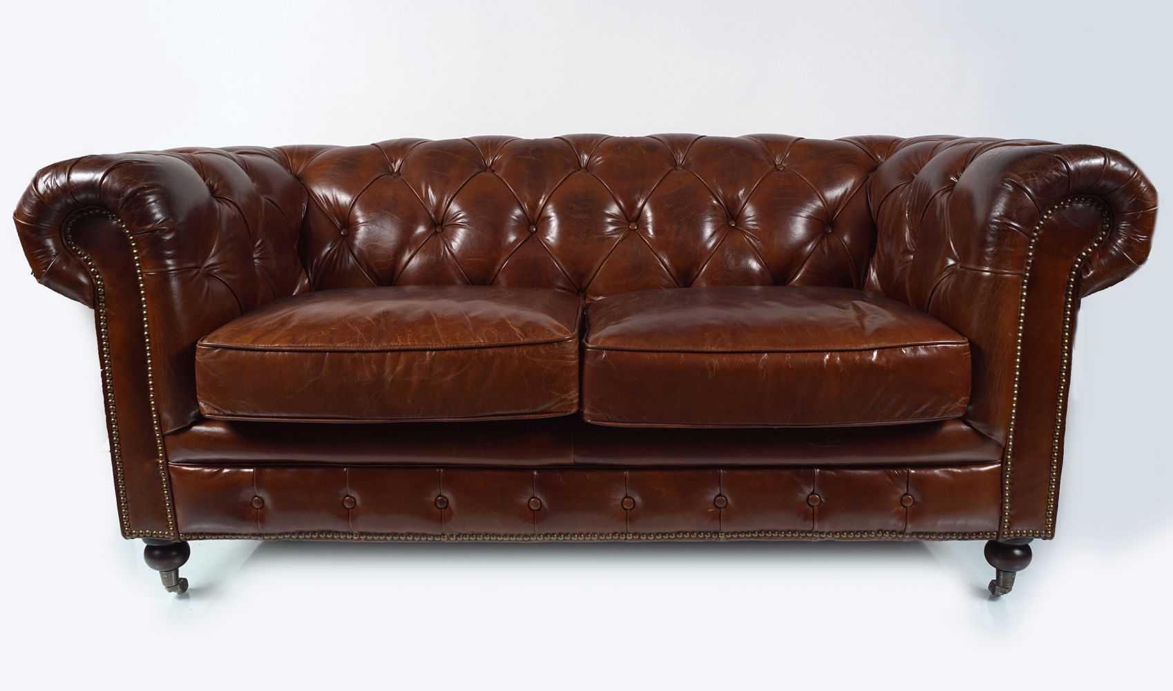 DEEP BUTTONED LEATHER CHESTERFIELD SETTEE