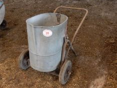 Pivoting feed bucket on frame