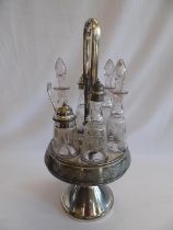 Plated revolving condiment stand with six etched glass bottles