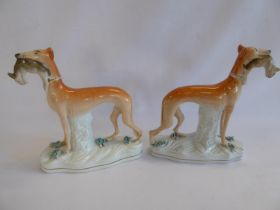 Pair 19thC Staffordshire coursing hound and hare figures
