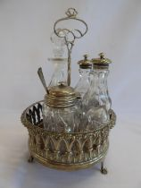 Silver condiments stand, silver topped bottles etc.
