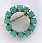 A ROUND BROOCH 585/000 yellow gold with turquoises. Diameter 27 cm long, gross weight