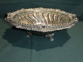 A large early 20th century silver plated swing handle Fruit Bowl, three footed circular form,