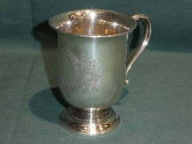 A George VI silver Christening Mug, U shape on stepped circular foot, S scroll handle, reserved with