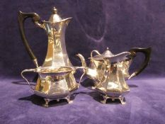 A George VI Art Deco silver Four Piece Tea Service, tapering octagonal form with hinged lids to