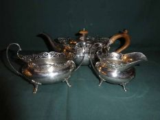 An early 20th century silver Three Piece Tea Service, oval form with pierced rim, open top sucrier