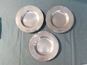 A set of three small Anglo Scottish pewter dishes, broad circular rim with English Three Lions