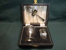 An early 20th century silver plated three-piece Christening set in fitted case