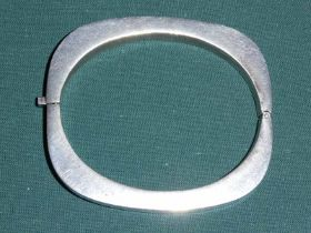 An Art Deco Mexican Silver hinged Bangle of rounded rectangular form, 7.5cm by 6.5cm