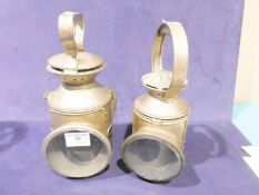 Two Railway hand lamps, coloured lenses missing to both