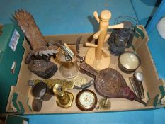 A box of mixed collectables inc Treen bellows, carved Eagle, Magnifier, brass Storm Lamp etc