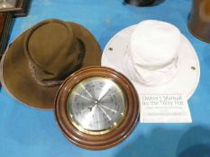 Tilley Hat, Leather Bush Hat and Circular Barometer