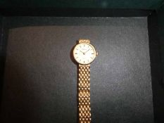 An Empress 9ct gold cased Ladies Wrist Watch with 9ct gold bracelet, 19.7g gross weight